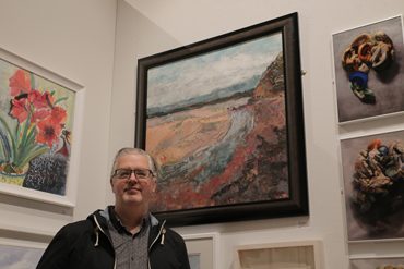 Thumbnail image of Alan Hopwood in front of 'Low Tide across St Austell Bay' - LSA Annual Exhibition 2017 Prize Winners