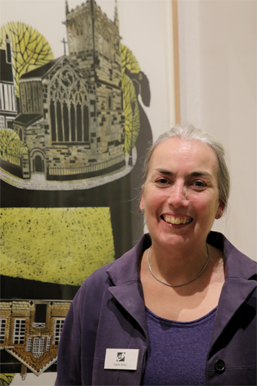 Thumbnail image of Sarah Kirby in front of 'St Mary de Castro and Castle Yard', linocut - LSA Annual Exhibition 2017 Prize Winners