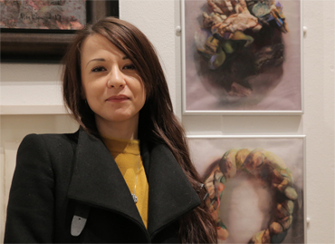 Thumbnail image of Stefania Laccu in front of 'Psychosomatic Skin Disorders' (triptych) - LSA Annual Exhibition 2017 Prize Winners