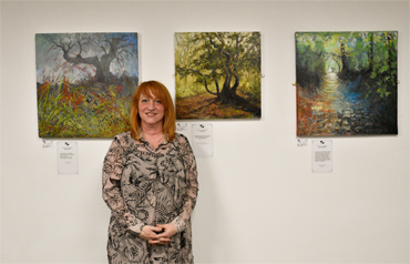 Thumbnail image of Jo Sheppard with her three works: - Beyond Words: An Exploration Of Art And The Written Word