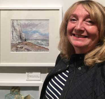 Thumbnail image of Sue Grahamwith her work at The Open Exhibition - The Open Exhibition