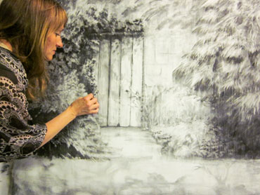 Thumbnail image of Jo Sheppard working on a charcoal drawing by Jo Sheppard
